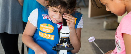 Girl Scout does a STEM activity with a microscope